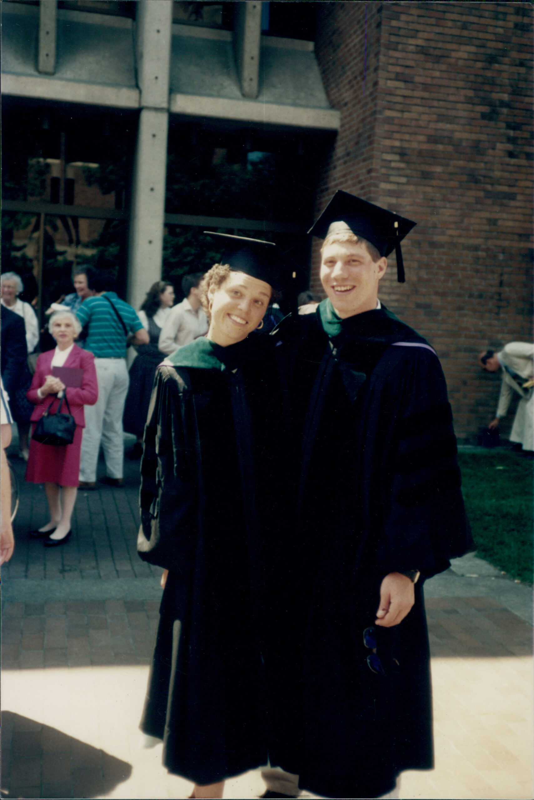 Photo of Al and Monica in graduation robes and caps.